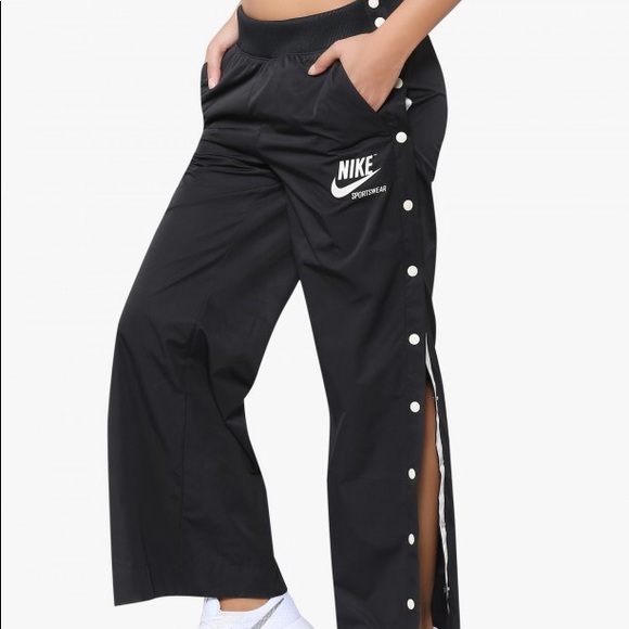 Nike track pants with buttons down the side. 🖤🖤